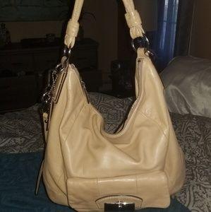 Bone colored Coach bag.